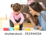 portrait of a mother scolding... | Shutterstock . vector #551944534