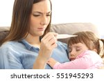 close up of a mother checking... | Shutterstock . vector #551945293