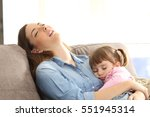 tired mother sleeping embracing ... | Shutterstock . vector #551945314