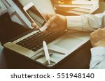 business traveller using his... | Shutterstock . vector #551948140