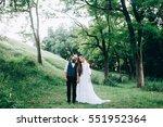 rustic wedding couple in the... | Shutterstock . vector #551952364