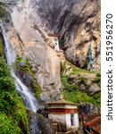 Small photo of A Buddhist pagoda at the foot of a waterfall and the seclusive parsonage of the Taktsang Monastery hidden between the cliff of a mountain