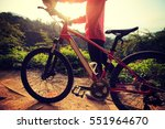 young woman riding mountain... | Shutterstock . vector #551964670