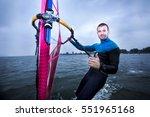 windsurfer enjoying the strong... | Shutterstock . vector #551965168