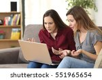 two confused friends watching... | Shutterstock . vector #551965654