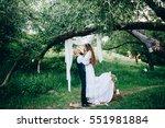 rustic couple at wedding... | Shutterstock . vector #551981884