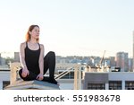 young woman doing yoga on the... | Shutterstock . vector #551983678