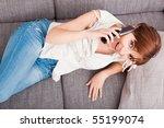 portrait of a woman lying on... | Shutterstock . vector #55199074