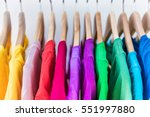 Stock photo fashion clothes on clothing rack bright colorful closet closeup of rainbow color choice of 551997880