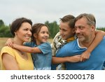 happy family at   field | Shutterstock . vector #552000178