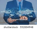 businessman using tablet with... | Shutterstock . vector #552004948