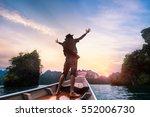 man raised hands enjoying to... | Shutterstock . vector #552006730