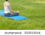 yoga in the park  outdoor with... | Shutterstock . vector #552015016