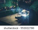 welder fusing metal together.... | Shutterstock . vector #552022780