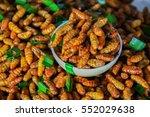 fired silk worm as snack in... | Shutterstock . vector #552029638