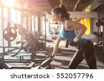 sporty girl lifting weights in... | Shutterstock . vector #552057796