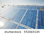 solar panels against blue sky | Shutterstock . vector #552065134