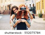 two happy pretty young best... | Shutterstock . vector #552075784