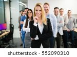 group of happy business people... | Shutterstock . vector #552090310