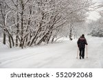 man walking on snow with ... | Shutterstock . vector #552092068