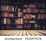 Blurred image many old books on ...
