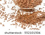 flax seeds on white background | Shutterstock . vector #552101506