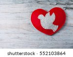 felt grey dove on red hand made ... | Shutterstock . vector #552103864