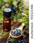 juniper berries and essential...   Shutterstock . vector #552121486
