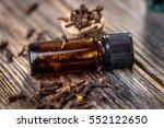 clove essential oil and cloves... | Shutterstock . vector #552122650