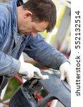 man worker repairing bumper car ... | Shutterstock . vector #552132514