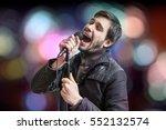 karaoke concept. young man... | Shutterstock . vector #552132574