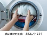 hand and puts the laundry into... | Shutterstock . vector #552144184