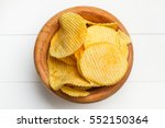 chips in a wooden bowl   Shutterstock . vector #552150364