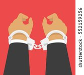 handcuffs on the hands of the... | Shutterstock .eps vector #552159256