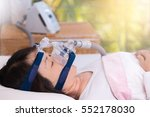 Small photo of Obstructive sleep apnea therapy, Woman wearing CPAP mask. CPAP:Continuous positive airway pressure therapy.Happy and healthy senior woman breathing more easily during sleep without snoring.
