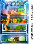 open refrigerator filled with... | Shutterstock . vector #552193330