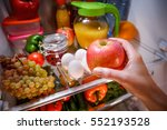 woman takes the apple from the... | Shutterstock . vector #552193528