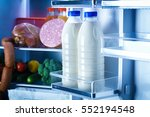 open refrigerator filled with... | Shutterstock . vector #552194548