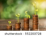 coins stack growing graph with...   Shutterstock . vector #552203728
