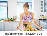 young sportive woman in... | Shutterstock . vector #552204328
