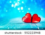 two ceramic hearts on the blue  ... | Shutterstock . vector #552223948