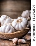 garlic cloves and bulb in... | Shutterstock . vector #552242509