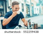 young man drinking morning... | Shutterstock . vector #552259438