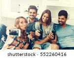 cheerful group of friends... | Shutterstock . vector #552260416