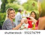 group of friends doing a bbq ... | Shutterstock . vector #552276799