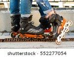 Legs Wearing Rollerblades....