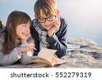 children reading a book... | Shutterstock . vector #552279319