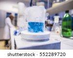 blue liquid freezing in beaker... | Shutterstock . vector #552289720