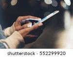 girl pointing finger on screen... | Shutterstock . vector #552299920