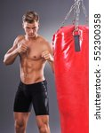 muscular fighter prepare for... | Shutterstock . vector #552300358